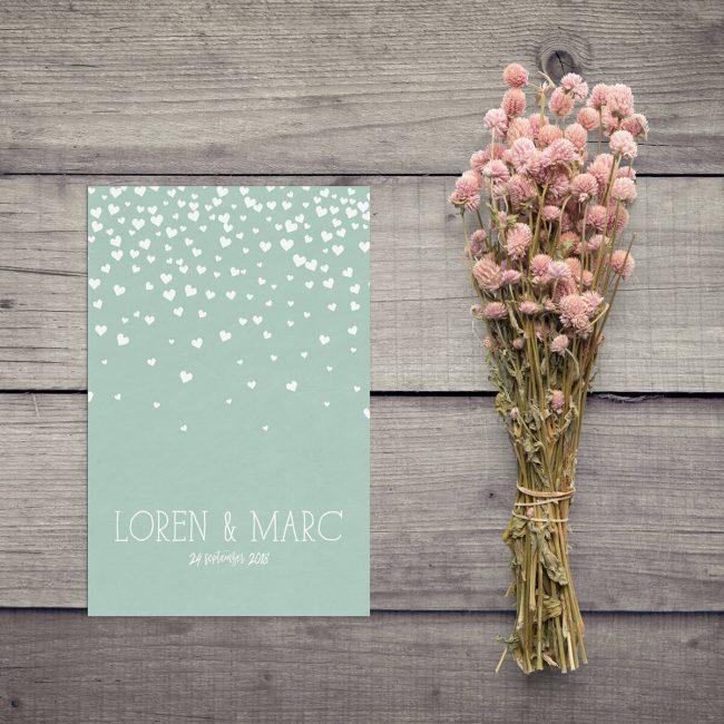 Het regent liefde op trouwkaart Hartjes. Hét universele symbool van liefde wordt op stijlvolle manier gebruikt om jullie liefde voor elkaar uit te beelden.