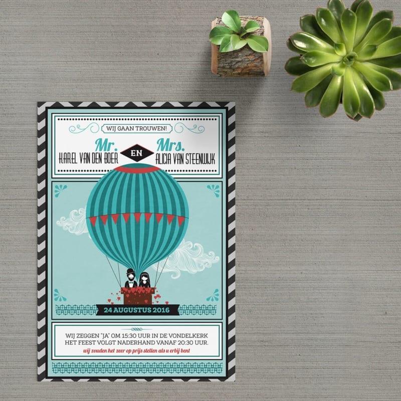 Trouwkaart Ballontocht is moderne uitnodiging met retro elementen, zoals de poppetjes in het mandje van de grote luchtballon.